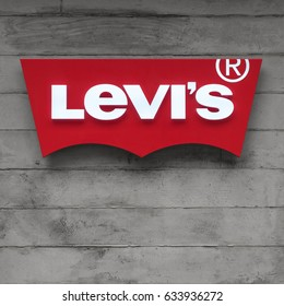 TOKYO, JAPAN - CIRCA MARCH, 2017: Levi's logo with concrete background. Levi Strauss & Co. is an American clothing company known worldwide for its brand of denim jeans. It was founded in May 1853.