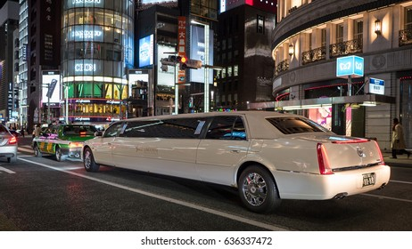 TOKYO, JAPAN - CIRCA MARCH, 2017: Luxury limousine at night in Ginza area.