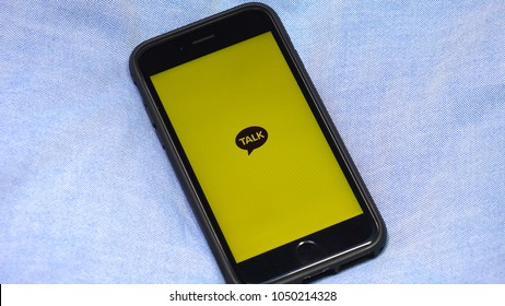 TOKYO,  JAPAN - CIRCA MARCH 2018 : Message app KAKAO TALK logo on iphone screen.