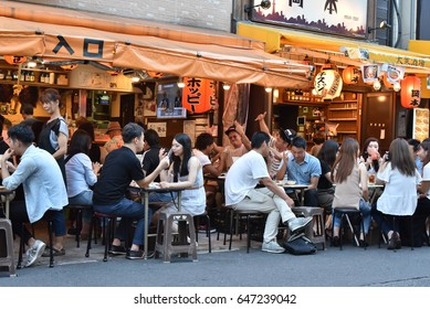 Tokyo, Japan – CIRCA September 2016: People have dinner in izakaya in Asakusa district