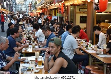 Tokyo, Japan – CIRCA September 2016: People have dinner in izakaya in Asakusa district