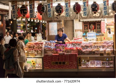 Tokyo, Japan – CIRCA September 2016: Seller behind food stall in Asakusa