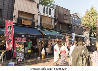 Tokyo, Japan – CIRCA September 2016:People walk in the street of Asakusa district in Tokyo.