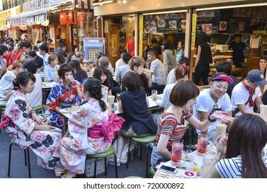 TOKYO, JAPAN - CIRCA September 2016:People have lunch in izakaya in Asakusa