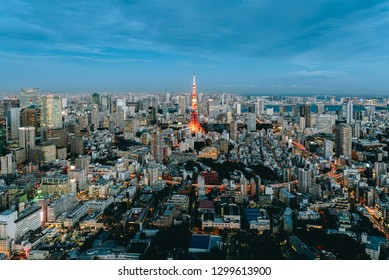 Tokyo, Japan - Dec 04, 2018: Tokyo city view with Tokyo Tower visible on the horizon at sunset time. Tokyo is both the capital and largest city of Japan.