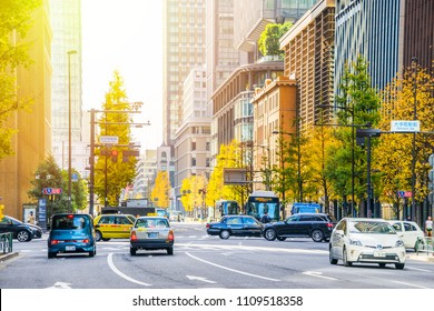 Tokyo, Japan - Dec 2, 2017:  view of modern city skyline and business street at morning sky, the city life in tokyo, japan