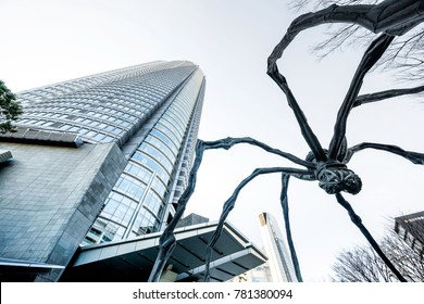 Tokyo, Japan - Dec 6, 2017: looking up view of Mori Building and spider sculpture Maman by Louise Bourgeois at Roppongi Hill, Tokyo, Japan.