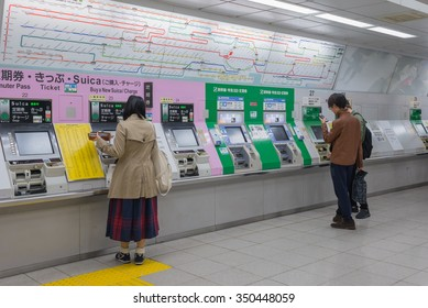 Tokyo, Japan - December 1, 2015: Passengers are buying Shinkansen tickets from vending machines inside JR Shinjuku Station. Passengers can buy any high-speed train passes in Japan from the machine.