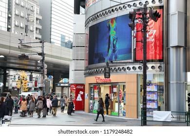 TOKYO, JAPAN - DECEMBER 1, 2016: People walk in Roppongi district of Tokyo, Japan. Tokyo is the capital city of Japan. 37.8 million people live in its metro area.