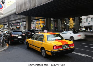 TOKYO, JAPAN - DECEMBER 1, 2016: Taxi cab drives in Roppongi district of Tokyo, Japan. Tokyo is the capital city of Japan. 37.8 million people live in its metro area.