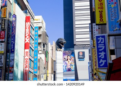 Tokyo, Japan - December 1, 2018: The life-sized replica of Godzilla overlooks the Kabukicho entertainment district from the eighth floor of Hotel Gracery