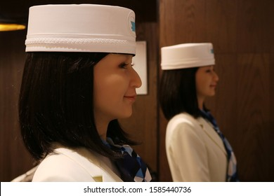 TOKYO, JAPAN - December 10, 2019: Robot receptionists working on the reception desk of a Henna Hotel in Ginza. The hotel is owned by H.I.S. hotel chain. Shallow depth of field.