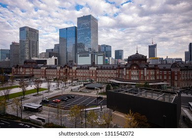 Tokyo, Japan - December 12 2018: The exterior of historic Tokyo Station and the skyline of the commercial area in Autumn.