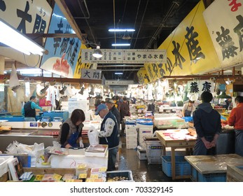 TOKYO, JAPAN - DECEMBER 12 : Seafood shop in Tsukiji Market in Tokyo taken December 12, 2015. Tsukiji Market is the biggest wholesale food market in Japan.
