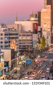 TOKYO, JAPAN - December 15 2018 : Bird's view of the Japanese youth culture fashion's district crossing intersection of Harajuku Laforet named champs-élysées in Tokyo, Japan at sunset.