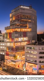 TOKYO, JAPAN - December 15 2018: Bird's view of Q plaza building in the Japanese youth culture fashion's district of Harajuku near to Laforet crossing intersection in Tokyo, Japan at sunset blue hour.