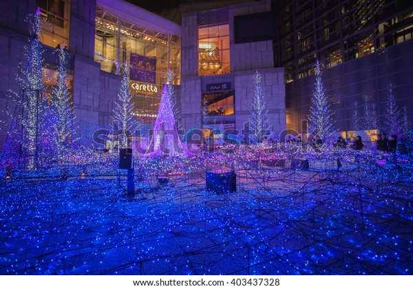 Tokyo, Japan - December 16, 2015: Winter Illumination in Shiodome, Tokyo. Christmas trees decorated with LED lights is the signature of illumination here.
