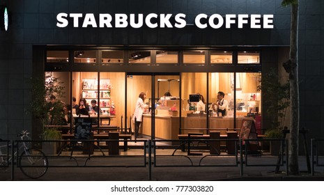 TOKYO, JAPAN - DECEMBER 17TH, 2017. Starbucks coffee outlet in Nakameguro at night.