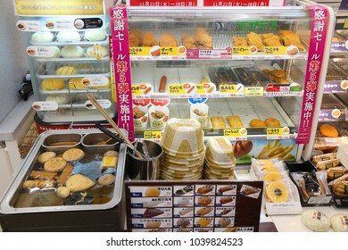 TOKYO, JAPAN - DECEMBER 2, 2016: Typical Japanese convenience store fast food set in Tokyo. Nikuman steamed buns, oden broth winter foods and choice of fried meats.