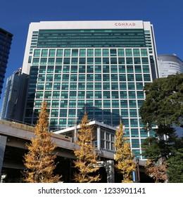 TOKYO, JAPAN - DECEMBER 2, 2016: Hotel Conrad skyscraper in Tokyo, Japan. It is one of top 10 best rated hotels in Tokyo according to Tripadvisor.