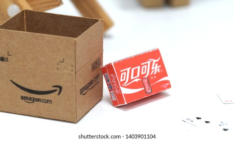 Tokyo, Japan - December, 2017: Danbo figurine with Amazon and Coca Cola packaging