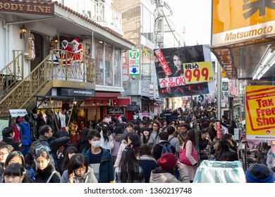 Tokyo, Japan - December 21, 2014: A lot of people on Takeshita Street, a famous shopping and pedestrian street in Harajuku district.