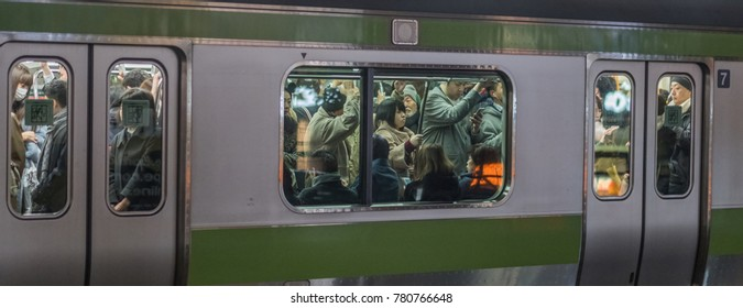 TOKYO, JAPAN - DECEMBER 21ST, 2017. Crowded commuters in Japan Railway Yamanote train at night.