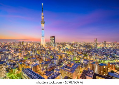 TOKYO, JAPAN - DECEMBER 28, 2015: The Skytree towers over Sumida Ward in Tokyo at dusk.