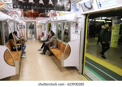 TOKYO, JAPAN - DECEMBER 3, 2016: Passengers ride a metro train in Tokyo. With more than 3.1 billion annual passenger rides, Tokyo subway system is the busiest worldwide.
