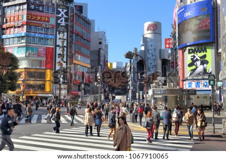 TOKYO, JAPAN - DECEMBER 3, 2016: People visit Shibuya Crossing in Tokyo.Tokyo is the capital city of Japan. 37.8 million people live in its metro area.
