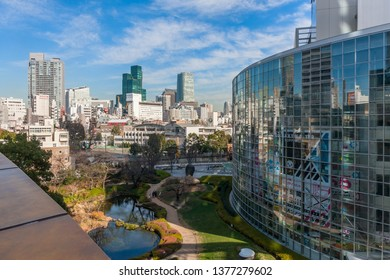 TOKYO, JAPAN - DECEMBER 30, 2013: View of the Roppongi district with tall office buildings, the Mori Garden and the TV Asahi headquarters.