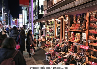 TOKYO, JAPAN - DECEMBER 4, 2016: People shop at night in Takeshita Street, Harajuku district of Tokyo, Japan. Tokyo is the capital city of Japan. 37.8 million people live in its metro area.