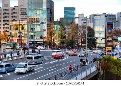 TOKYO, JAPAN - DECEMBER 4, 2016: People visit evening Harajuku district of Tokyo, Japan. Tokyo is the capital city of Japan. 37.8 million people live in its metro area.
