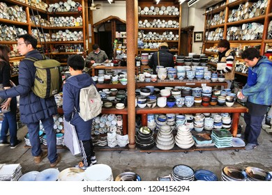 TOKYO, JAPAN - DECEMBER 4, 2016: Japanese ceramic tableware store Kappabashi area of Asakusa in Tokyo, Japan. Kappabashi Street is known for its multiple stores selling restaurant equipment.
