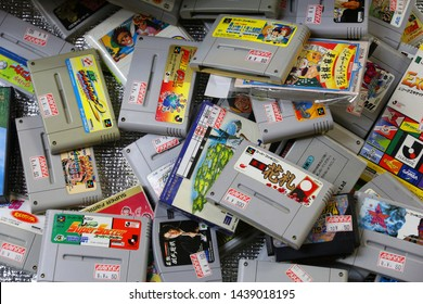 TOKYO, JAPAN - DECEMBER 4, 2016: Retro video game collectible store SNES bargain bin in Akihabara district of Tokyo, Japan. Akihabara Electric District specializes in anime and video games.
