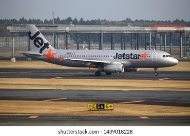 TOKYO, JAPAN - DECEMBER 5, 2016: Jetstar Japan Airbus A320 is towed at Narita Airport of Tokyo. The airport is the 2nd busiest airport of Japan (after Haneda) with 34,751,221 annual passengers (2015).