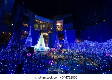 Tokyo, Japan - December 6, 2014: Winter Illumination in Shiodome, Tokyo. Christmas trees decorated with LED lights is the signature of illumination here.