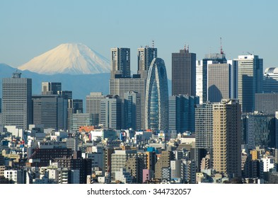 Tokyo, Japan - December 7, 2014: Tokyo Skyline and Mount Fuji. Tokyo is one of the most population density city and world's economic center.
