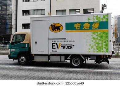 TOKYO, JAPAN - December 7, 2018: A Yamato Transport Company (Kuroneko) Mitsubishi Fuso Truck and Bus Corporation EV truck in Kayabacho.
