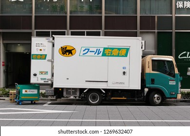 TOKYO, JAPAN - December 7, 2018: A Yamato Transport Company (Kuroneko) truck making a delivery in Tokyo's Hibiya area.