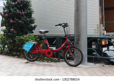 TOKYO, JAPAN - December 7, 2018: An electric bikes belonging to Toyko's public bicycle sharing scheme parked on a sidewalk in Kayabacho in central Tokyo.