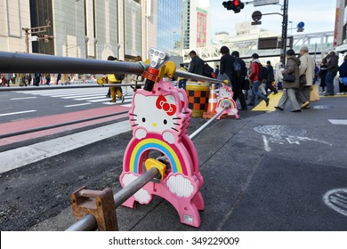 Tokyo, JAPAN - December 9 2015 : A road construction project with Hello Kitty barrels