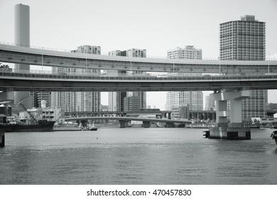 Tokyo, Japan - elevated expressway of Rainbow Bridge. Black and white vintage style.