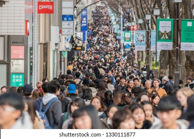 TOKYO, JAPAN - FEB 2019 :Ccrowd of undefined people prevent freedom of movement walking on the street around fashion mall in Harajuku on Febuary 16, 2019 in Tokyo, Japan,culture and congestion concept
