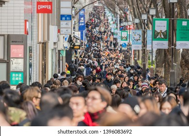 TOKYO, JAPAN - FEB 2019 : Crowd of undefined people prevent freedom of movement walking on the street around fashion mall in Harajuku on Febuary 16, 2019 in Tokyo, Japan,culture and congestion concept