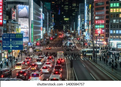 TOKYO, JAPAN - FEB 2019 : Crowd of undefined people walking on the street cross-walk with car traffic in Shinjuku on Febuary 16, 2019 in Tokyo, Japanese culture and shopping neon street concept