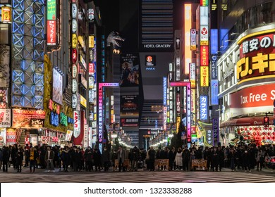 TOKYO, JAPAN - FEB 2019 : Crowds Undefined people walking around Kabukicho which is one Shopping neon street of shinjuku area at night time on Febuary 15, 2019 in Tokyo, Japan.