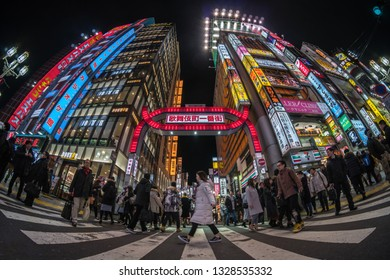 TOKYO, JAPAN - FEB 2019 : Fisheye Scene of Kabukicho which is one Shopping neon street of shinjuku area with crowds undefined people walking at night time on Febuary 15, 2019 in Tokyo, Japan.