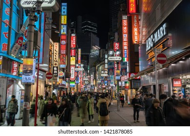 TOKYO, JAPAN - FEB 2019 : Many Undefined Japanese and foreign tourist visiting market shopping street at night time on Febuary 14, 2019 in Tokyo, Japan. Shibuya Station is a railway station in Shibuya
