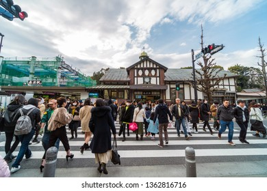 TOKYO, JAPAN - FEB 2019 : Undefined people and tourist crowd visiting and walking on the street cross-walk at Harajuku station on Febuary 16, 2019, Japanese culture and shopping area concept